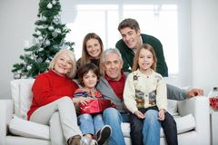 Family With Christmas Present In House Royalty Free Stock Photos