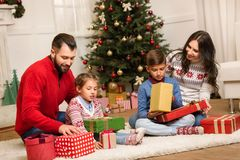 Family with christmas presents Stock Photos