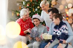 Family with Christmas presents. Smiling family at Christmas time holding lots of presents at home Stock Image