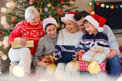 Family with Christmas presents. Smiling family at Christmas time holding lots of presents at home Royalty Free Stock Photo
