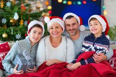 Family with Christmas presents. Smiling family at Christmas time holding lots of presents at home Stock Photos