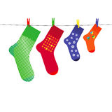 Family Christmas Socks on Clothesline with Pegs Stock Photos