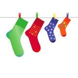 Family Christmas Socks on Clothesline with Pegs Stock Photos