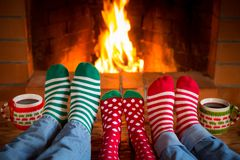 Family in Christmas socks near fireplace stock images