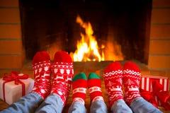 Family in Christmas socks near fireplace royalty free stock photo
