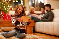 Family, Christmas, technology, music concept - little girl with. Family, Christmas, technology, music concept – smiling little girl with tablet pc and stock photography