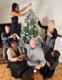 Family christmas tree. Happy family decorating together the christmas tree Royalty Free Stock Photos