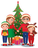 Family at Christmas tree with gifts. Cartoon vector illustration of a family at the Christmas tree with gifts  on white background Royalty Free Stock Photos