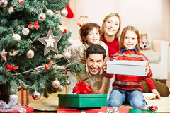 Family at christmas tree with gifts Stock Image