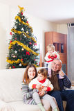 Family with Christmas tree Royalty Free Stock Photography