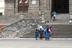 Family by the church steps stock images