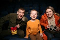 Family in cinema. Family with son in stereo cinema royalty free stock photos