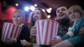 Family in the cinema. Family with popcorn in the cinema