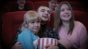 Family in the cinema stock footage