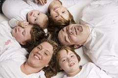 Family circle. A family of six lying together in a circle Royalty Free Stock Photo