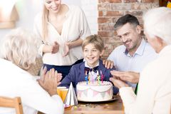 Family clapping their hands at a party Stock Image