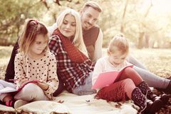 Family class in nature. Young family enjoying in autumn day royalty free stock image