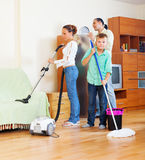 Family with  cleaning equipment Royalty Free Stock Images