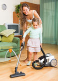 Family cleaning home with vacuum cleaner Stock Photography