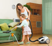 Family cleaning home with vacuum cleaner Stock Images