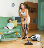 Family cleaning home with vacuum cleaner Stock Photos