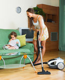 Family cleaning home with vacuum cleaner Stock Image