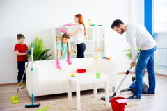 Family cleaning house. Happy family of four is cleaning their house Stock Photography