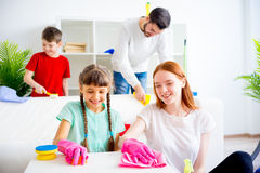 Family cleaning house. Happy family of four is cleaning their house royalty free stock photos