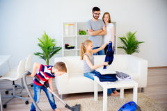 Family cleaning house Stock Photography