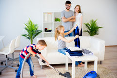 Family cleaning house Stock Photo