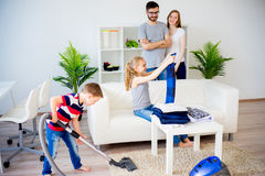 Family cleaning house Stock Images