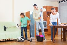 Family cleaning in living room Stock Photo
