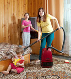 Family is cleans living room Royalty Free Stock Images