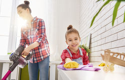 Family cleans the room Stock Image
