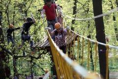 Family climbing rope Stock Photos