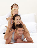 Family climbing on top of each other in bed Royalty Free Stock Photo