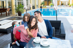Family close to the pool Stock Photography