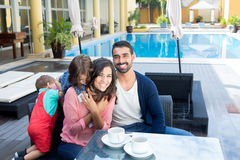 Family close to the pool. Beautiful latin family relaxing close to the pool Royalty Free Stock Photography