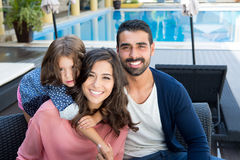 Family close to the pool. Beautiful latin family relaxing close to the pool Stock Photo