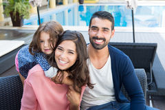 Family close to the pool Royalty Free Stock Image