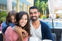 Family close to the pool Royalty Free Stock Images