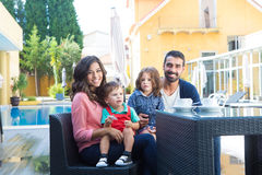 Family close to the pool. Beautiful latin family relaxing close to the pool Stock Image