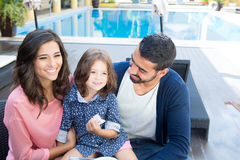 Family close to the pool Stock Images