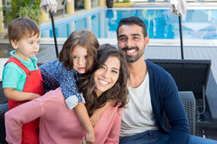 Family close to the pool. Beautiful latin family relaxing close to the pool Royalty Free Stock Images