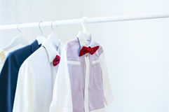 Family clothes. Baby shirt, red bow tie, mens shirt Stock Images