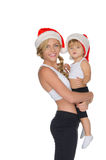 Family clothing for fitness and Santa hats Royalty Free Stock Photography