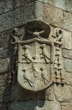 Family coat of arms shield carved on stone in a gothic Cathedral. Charming family coat of arms shield carved on stone in a wall of gothic Cathedral, in a sunny royalty free stock image