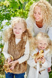 Family collecting leaves stock image