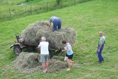 Family Collects Hay On A Tractor, Agricultural Industry In Czech Republic Stock Photography