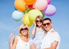 Family with colorful balloons Stock Photos